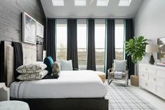 Designer Tiffany Brooks says the master bedroom is one of her favorite rooms in HGTV Smart Home It's a well-detailed space with a modern queen bed with a smart mattress, seating area for relaxing and a smart TV that doubles as artwork when not in use. Bedroom Ceiling, Bedroom Wall, Bedroom Windows, Bedroom Curtains, Bedroom Decor, Guest Bedrooms, Bedroom Sets, Modern Queen Bed, Relax
