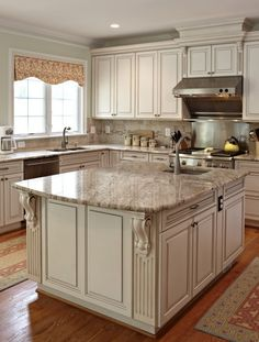 White Kitchen Vs Wood dark kitchen cabinets with white middle work island. | kitchens to