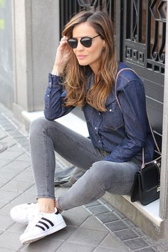 Blue denim shirt with gray jeans.