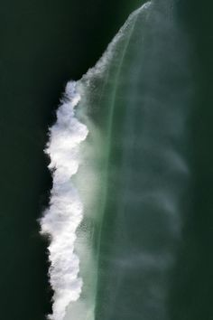 arial view of  a wave breaking