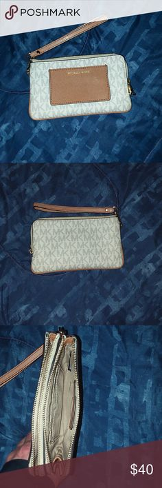 Michael Kors wristlet Vanilla Michael Kors wristlet is in excellent condition and was only used for a few weeks to carry my ID and paper money only. Never coins. Absolutely no signs of wear or tear. Michael Kors Bags Clutches & Wristlets