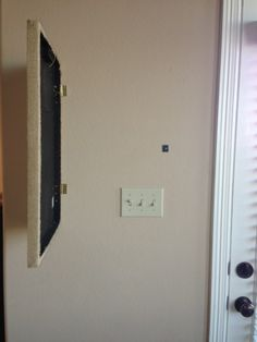 DIY:  Cover A Light Switch With A Picture - basic info on dressing up a wall with a light switch in an awkward place. Great way to hide an unattractive access panel, as well.