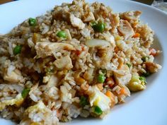 Better-Than-Takeout Chicken Fried Rice Serves 5-6 4 cups prepared rice 1/2 pound boneless, skinless chicken breasts, cooked (I recommend using Slow Cooker Teriyaki Chicken!) 1 cup peas & carrots, frozen 1 small white onion, chopped 2 cloves garlic, minced 2 eggs 3 tablespoons sesame oil 1/4 cup soy sauce
