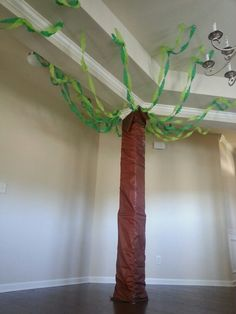 Lion King themed birthday party. Decor ideas. Tree. Streamers and brown plastic tablecover.