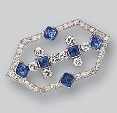 SAPPHIRE AND DIAMOND BROOCH, CARTIER, CIRCA 1925. The elongated hexagonal motif decorated with 4 sugarloaf cabochon sapphire and 2 French-cut sapphires, completed by 8 round and 38 single-cut diamonds weighing approximately 1.50 carats, mounted in platinum, signed Cartier by wteresa
