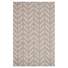 Anchor your dining set or living room seating group in chic style with this hand-tufted wool rug, showcasing an eye-catching arrow motif in grey and taupe.