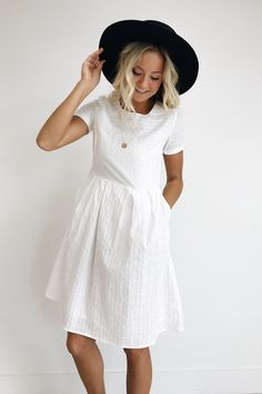 White Cotton A-Line Dress Striped Eyelet Detailing Fitted Bodice + Cuffed Short Sleeves Pleated Skirt w/Hidden Pockets Also Available in Rose