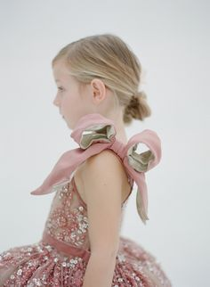 Doloris Petunia is the purveyor of a dazzling line of flower girl dresses with twirl-ability! Twirl-Ability \ˈtwər-(-ə)l ə-ˈbi-lə-tē\ adjective the expression of extreme jubilation through the act of spinning or whirling Hand-crafted, embellished with sparkling sequins, crystals and floral appliques, and all in a lovely array of colours, these are every...READ THE REST