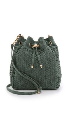 forest green leather or suede bucket bag. love the basket weave leather and gold metallic hardware on this it bag.