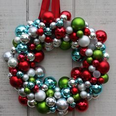 If mama's looking for an excuse to get new Christmas ornaments this year, here it is! Make a modern and festive Christmas wreath by gluing (with a glue gun) ornaments onto a styrofoam wreath. Tie a colorful ribbon at the top to hang.  Source: Matt