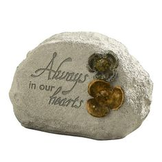 Grasslands Road Always in Our Hearts Remembrance Stone with Metal Flower Embellishments, Beaded with Message by Grasslands Road. $18.00. Message reads: Always in our hearts. Corrugated box. Beads in center of metal flower embellishments. Indoor/Outdoor use. Cement resin mix/metal/acrylic beads. Grasslands Road Always in Our Hearts Remembrance Stone with Metal Flower Embellishments Beaded with Message