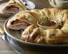 This easy to make, savory Tuscan stromboli ring is a hit wherever it's served: parties, game day get togethers, or your dinner table. It's even better the next day. Bake a few of these on Sunday and you'll have Monday night's dinner covered, too. It takes less than 10 minutes to assemble. Make it your own by adding different meats and cheeses or make it all cheese and veggies! The combinations are endless. Here's how: Tuscan Stromboli Ring recipe