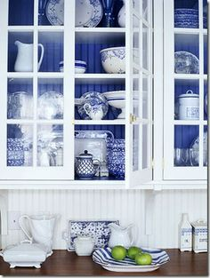 blue+white dishes.    +and the beadboard is lovely. :)