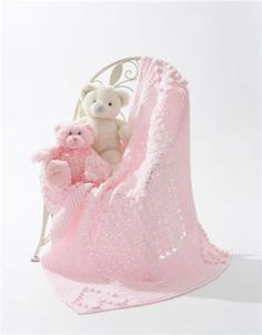 Using soft Snuggly Wuggly yarn, crochet a blanket for that special baby in your life