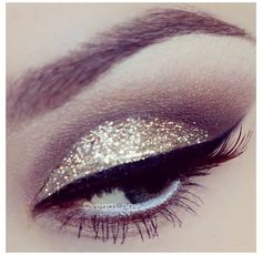 Gold eye shadow with bold eyeliner