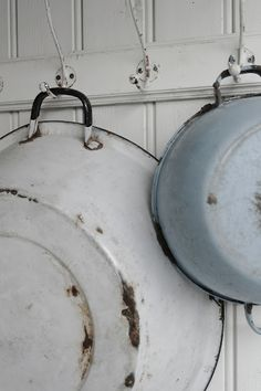 Old wash pans hung to dry