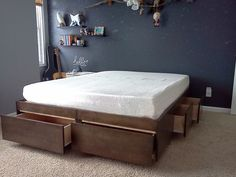 DIY bed base with storage  http://www.instructables.com/id/Platform-Bed-with-Drawers/?ALLSTEPS
