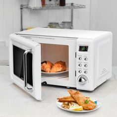 This isretro countertop microwave oven which has a compact size to fit your small apartments, studios, dorms, etc. This microwave oven offers 700 watts of power and 5 power levels along with 8 auto cook menus to help you efficien Oven Cooking, Cooking Time, Countertop Microwave Oven, Kitchen Oven, Wall Oven, Small Apartments, Food Preparation, No Cook Meals, Turntable