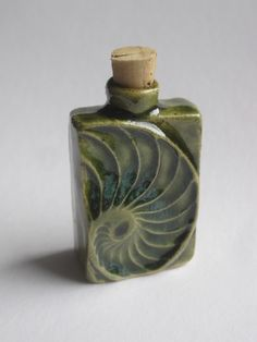 Nautilus bottle Height Hand built stoneware, copper glaze click the image or link for more info. Ceramic Boxes, Glass Ceramic, Ceramic Clay, Ceramic Pendant, Hand Built Pottery, Slab Pottery, Ceramic Pottery, Pottery Art, Clay Texture