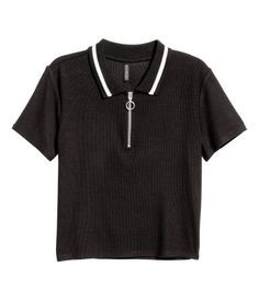 Black. Short polo shirt in soft, ribbed viscose fabric with a collar and zip at top.