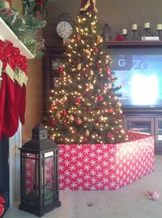 Large fake presents to protect the tree from baby- much prettier ...