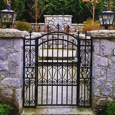 This lovely #wroughtiron and #stonework #gate graces the #entrance to a beautiful new #home in the #southgranville area of #vancouver.
