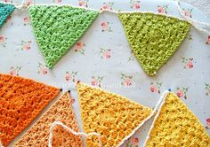"Crochet bunting -- I could also see this technique used to make granny square ""quilts"" in star patterns."