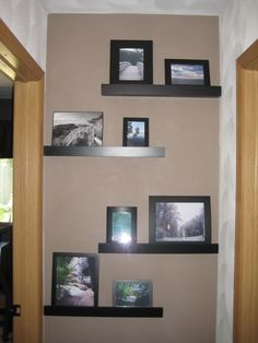 Brighten the end of a hallway with staggered shelves and a different wall color!