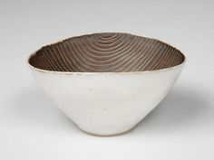 s-c-r-a-p-b-o-o-k: lucie rie - porcelainous stoneware, white tin glaze flecked with iron on exterior, excluding unglazed ring at base. Interior and inside foot has manganese glaze.