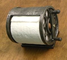 "This wall mounted fishing reel toilet paper holder is made of polyresin stone and measures 6.5"" W x 5.5"" H. Holds a double or standard roll of toilet paper. 