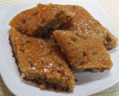 This traditional Palestinian sweet, is also prepared for mummies after delivery (same as caraway pudding), and it's so good any time of the year. If you know Basboosa (check Basboosa recipe), you'll see that recipe is little similar, a dough made of semolina flour (smeed) and all purpose flour, with some Fenugreek seeds and flavoured with cinnamon and anise, then sweetened with sugar syrup when it's hot just out of the oven. This sweet is one of my favourites really, great with a cup of tea…