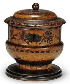 A REGENCY FRUITWOOD AND PENWORK TEA CADDY  EARLY 19TH CENTURY  Of oval waisted form, metal escutcheon and lock  5½ in. (14 cm.) high