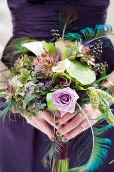 Succulents, Peacock feathers, and lavendar roses in a bouquet #peacock #wedding #decor #flowers
