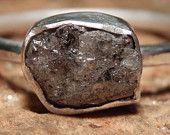Sterling silver and dark grey rough diamond ring. $75.00, via Etsy.