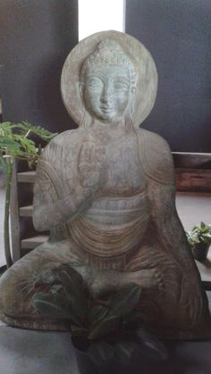 "Buddha statue that is 40"" tall but only 5"" thick, perfect for a balcony or where space is a premium, has a hook for display on a wall. solid cast-stone, acid stained."
