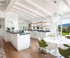 Marin Bungalow by Feldman Architecture Here's an idea: Get rid of the breakfast bar and just have a simple round table.