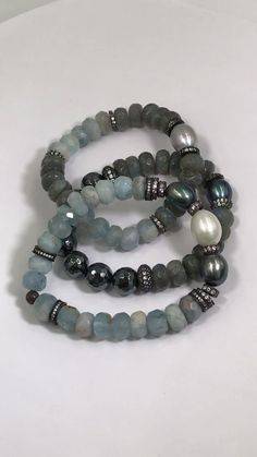 Blue aquamarine, pearls and labradorite mix with a luxe amount of oxidized silver pave cz beads and gleaming hematite to create this boho luxe bracelet set. Beach Bracelets, Layered Bracelets, Gemstone Bracelets, Bracelet Set, Bracelet Making, Jewelry Bracelets, Aquamarine Bracelet, Hematite Bracelet, Yoga Bracelet