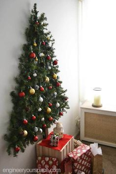DIY wall mounted Christmas tree with pine garlands - space saver Christmas tree perfect for small apartments! DIY wall mounted Christmas tree with pine garlands - space saver Christmas tree perfect for small apartments! Wall Christmas Tree, Christmas Holidays, Outdoor Christmas, Xmas Trees, Christmas Wall Decorations, Christmas Tree With Toddler, Christmas Tree For Apartment, Christmas Tree Ideas For Small Spaces, Christmas Decorations Apartment Small Spaces