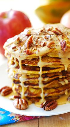 Perfect Thanksgiving breakfast or brunch: pumpkin pancakes drizzled with caramel pecan sauce. Or, you can drizzle them with dulce de leche (cooked sweetened condensed milk) JuliasAlbum.com