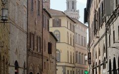 The famous narrow streets of Siena, Italy...fun place to walk around and get lost!  www.vivatuscanytours.com
