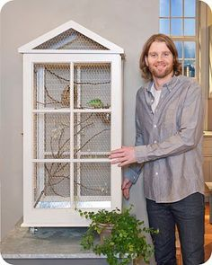 Birdcage made from old windows.