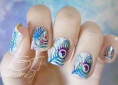 Check out this pretty watercolor nail art. Bring in colors of blue and red and combine them into a wonderful looking gradient. The design also forms a leaf like design.