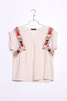 The chevron embroidery on this boho top would look great tucked into a suede skirt with gladiator sandals!