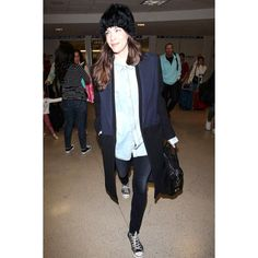 Liv Tyler in a cool Cossack hat and Converse