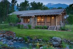 One Story cabin - love the windows and creek.