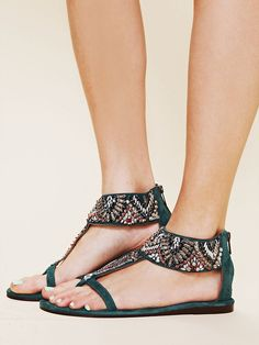 """Suede """"T""""-strap flat sandal with heavy bead and sequin embellishment on top. Zips up back of heel."""