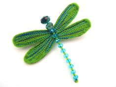 Dragonfly brooch. Love the stitching details.