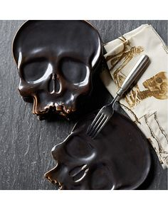 Festive Halloween skull plates are too fun! Get them here: http://www.bhg.com/shop/williams-sonoma-halloween-skull-plates-set-of-4-p51f814dbe4b06aabdb8a2d25.html