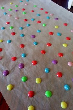 DIY Enamel Dots.... made with pony beads baked on wax paper at 400 degrees for approx 10 minutes