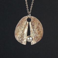 Elis Kauppi for Kupittaan Kulta, vintage sterling silver kinentic pendant, 1971. #Finland
